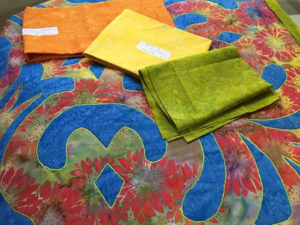 Auditioning binding fabrics.