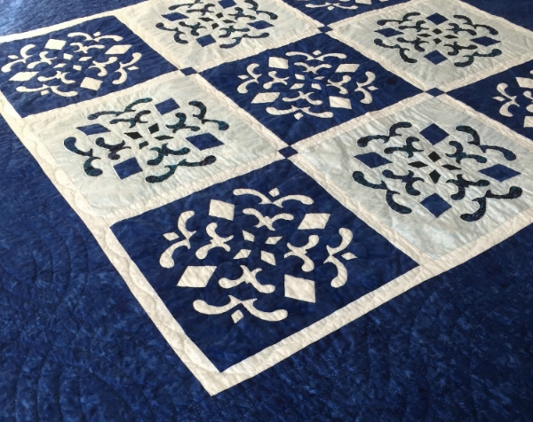 "Double Dutch Delft(56"" x 56""). 9-12"" blocks: 5 Reverse Applique, 4 Applique."