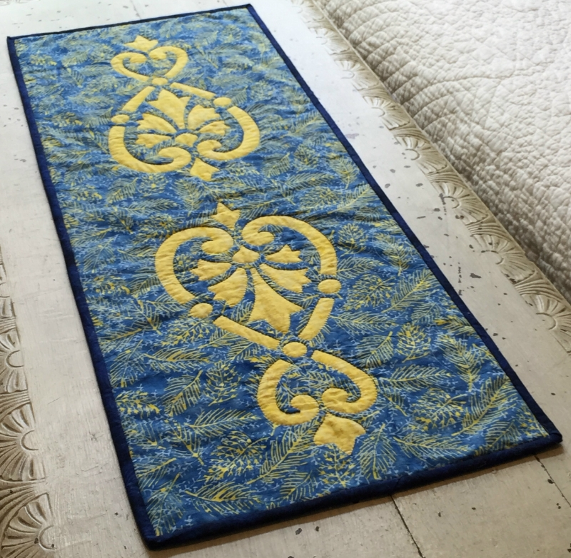 "Heart & Fleurs table runner    (13.5"" x 36"") for hand and machine. NEW fabrics from Island Batik.Ask us how to get this design as a FREE Shop Sample."