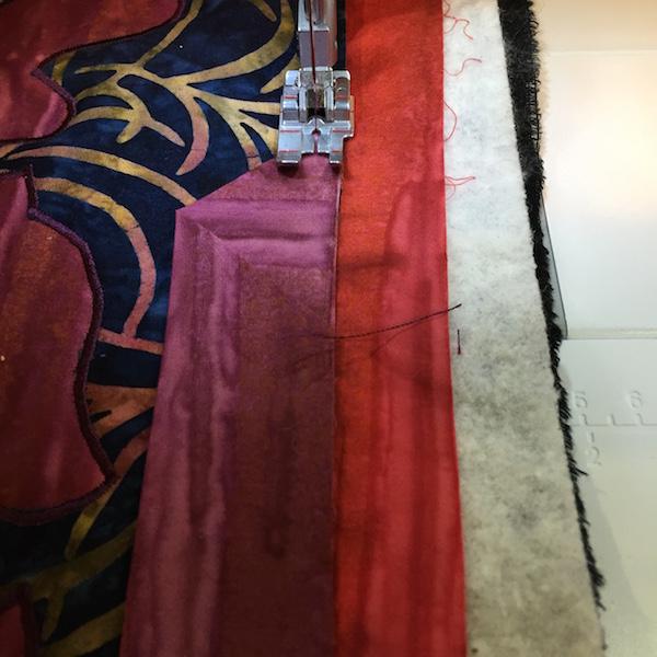 Sewing binding on: Finish along raw edge of top.