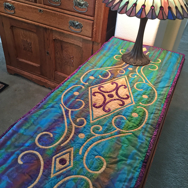 "Vintage Jewel    (18"" x 43"") table runner. Hand reverse applique"
