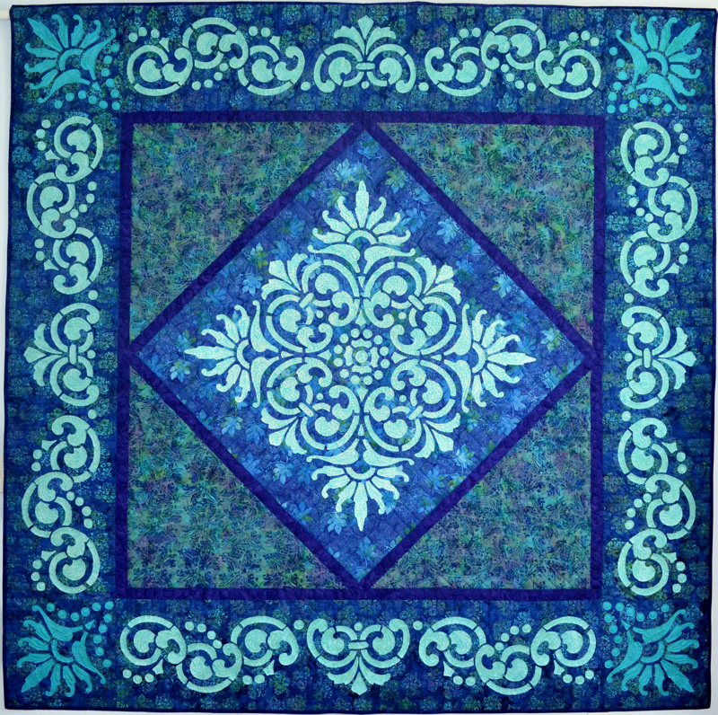 """Fit for a Queen Quilt (89"""" x 89""""). Hand or machine reverse applique pattern."""