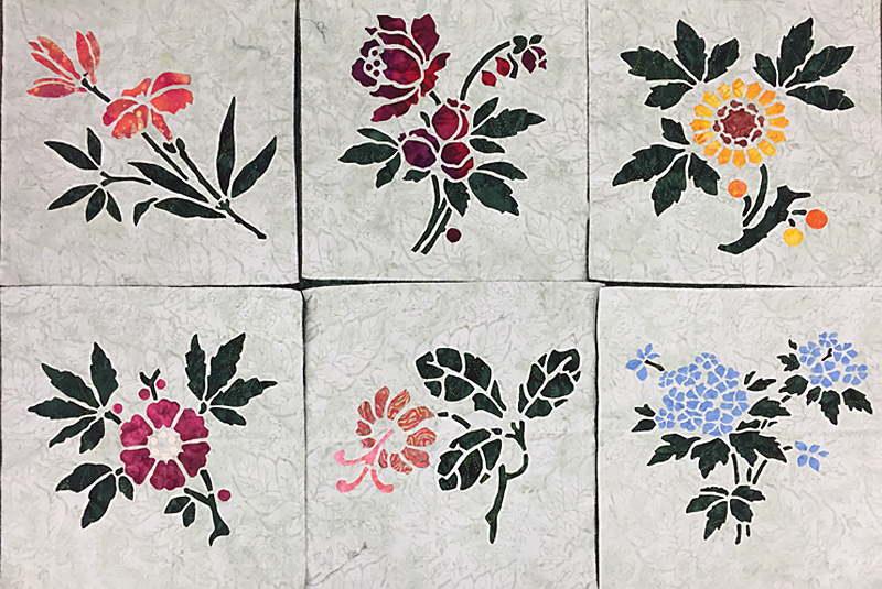 """Lily, Rose, Sunflower, Apple Blossom, Trumpet Vine and Forget-Me-Not (16"""" x 16""""). Reverse applique stems and leaves with Applique blossoms."""