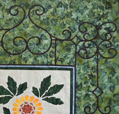 Victorian Flower Garden Quilt IV expansion. Border gate is appliqued onto the background fabric.
