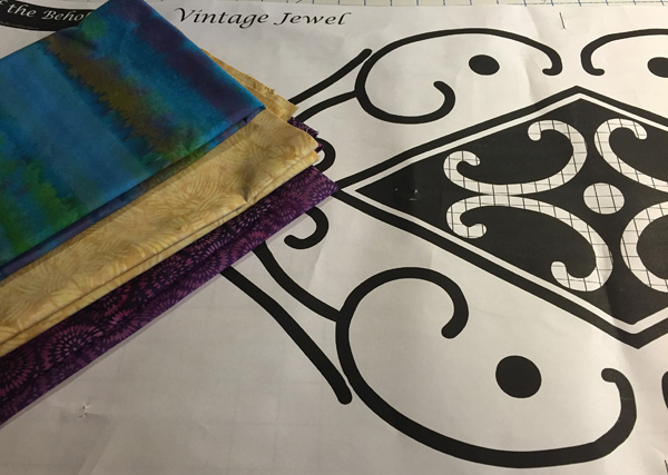 Island Batik fabrics and Vintage Jewel pattern piece. Notice the black and crosshatched shapes in the design.