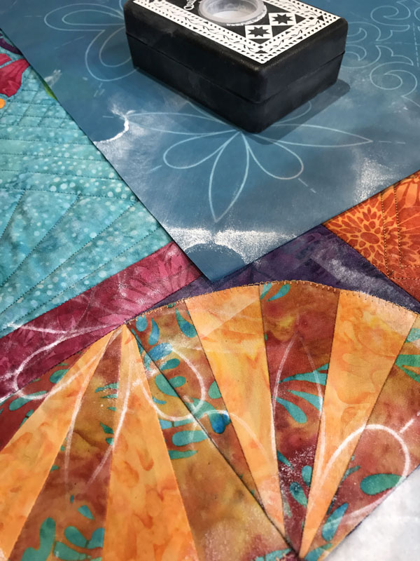 Used pounce pad and  #30692 Score of Four stencil  for quilting the fan border blocks.