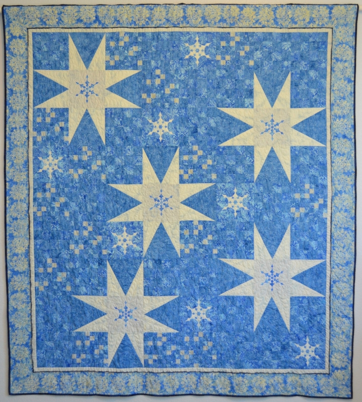 Twinkling Furries Quilt for hand and machine reverse applique.