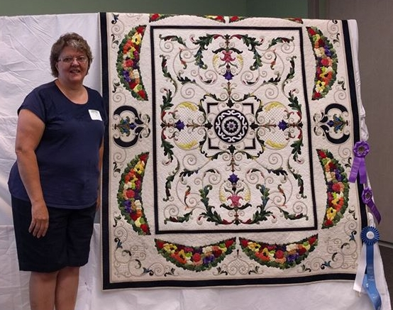 Sharon Engel with her one of her prize winning quilts.