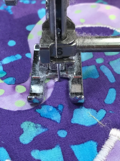 3. After stitching another 3 +/- stitches end with needle in the right hand position of the satin stitch.