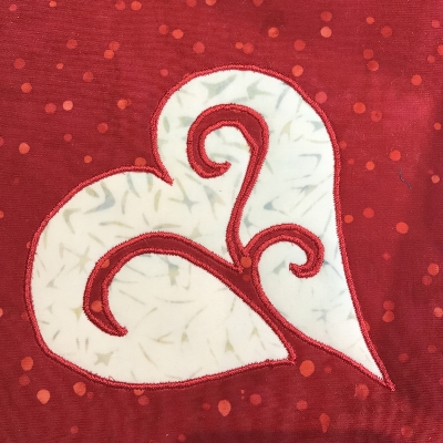 I used red Floriani embroidery thread for my machine reverse applique.