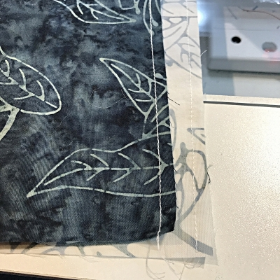 """stay stitch 1/4"""" from the raw edge on one side of each napkin square."""
