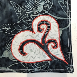 Charcoal gray side of napkins. Reverse applique white heart onto 2 napkins with red Floriani embroidery thread.