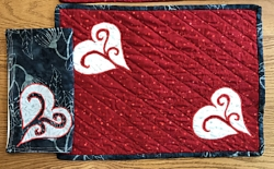 Red place mat with napkin ready for your table.