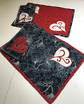 Red and Charcoal Gray place mats with 2 different napkins ready for your table.