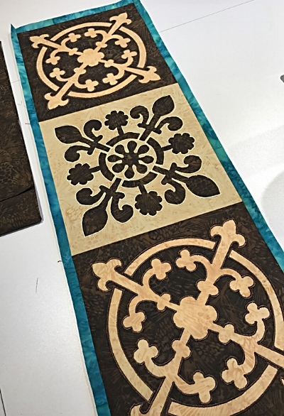 Pieced table runner with inner borders attached.