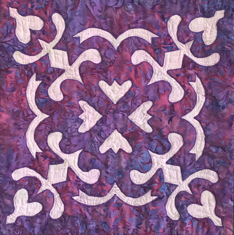 """Spring Love block (12"""" x 12"""") created by hand reverse applique using Trace, Baste, Snip & Stitch."""