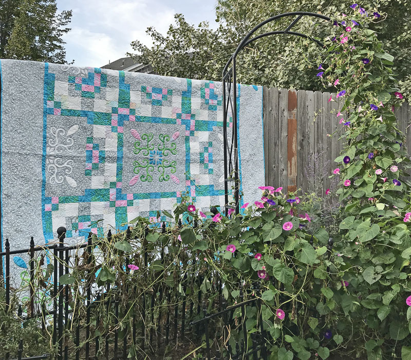 "Spring Breeze (98"" x 98""). hand or machine reverse applique with applique. Designed for Batik Textiles fall 2017."