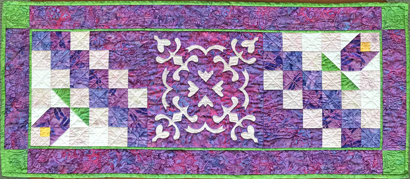 Flowers in the Wind table runner . Kits are also available for this pattern.