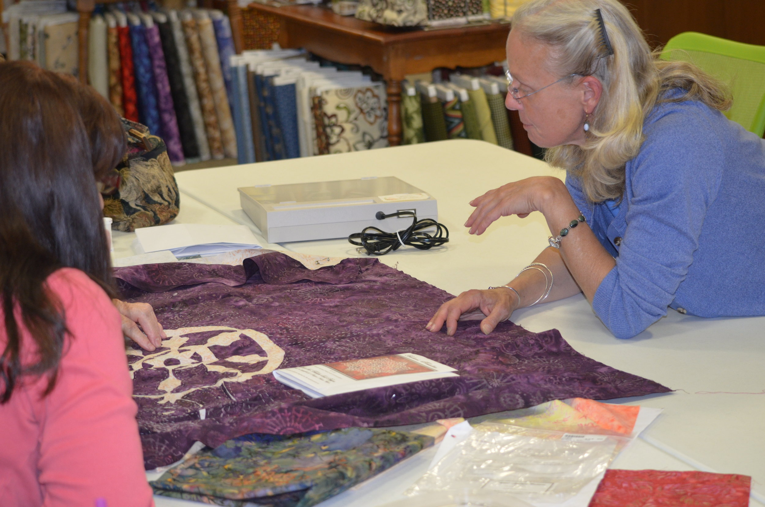 Margaret teaching her hand reverse applique method, 2012.