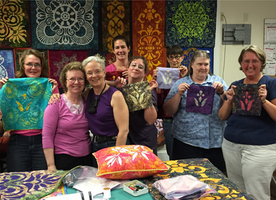 Smiley students showing their Lollipop Flower blocks. Students from Bunkhouse quilt shop, NH.