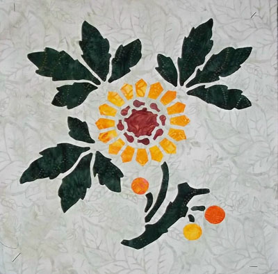 Sunflower, 3 of 9: 3 fabric. Reverse applique of stems & leaves, and applique blossoms.