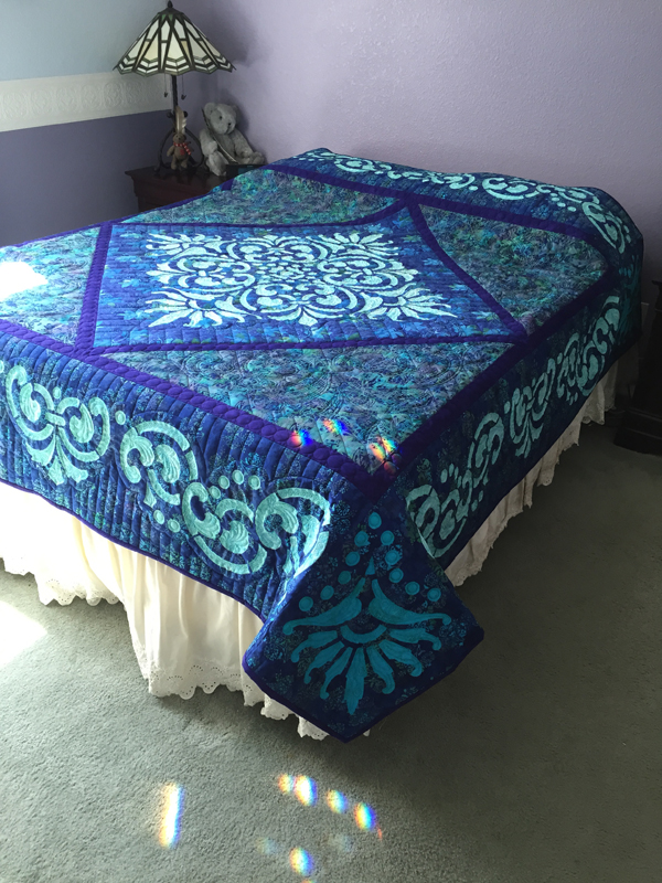 """Fit for a Queen Quilt III    (89"""" x 89""""). Hand or Machine reverse applique. This sample was Hand reverse applique and long arm quilted by Natalia Majors. Find out more below."""