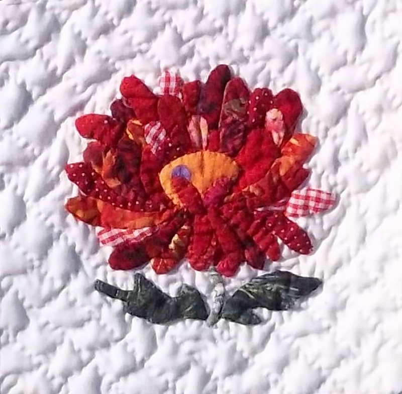 """Applique flower from """"Summer Flowers"""", an original design competition quilt by Margaret Brewster Willingham. hand applique, hand quilted."""