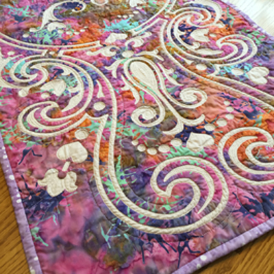 """Eternal Spring table runner VII   (18"""" x 43"""") Hand reverse applique, machine quilted. Fabrics by RJR Fabrics."""