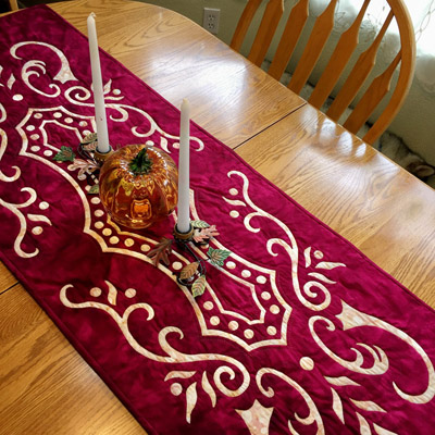 """Abounding Grace table runner VIII    (20"""" x 56"""") Hand reverse applique, hand quilted in the ditch. Fabrics by Batik Textiles."""
