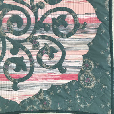 Whirlwind, Medallion VI  . Close up of quilting, with a modern-style concept in the reverse applique space, and a corner motif.