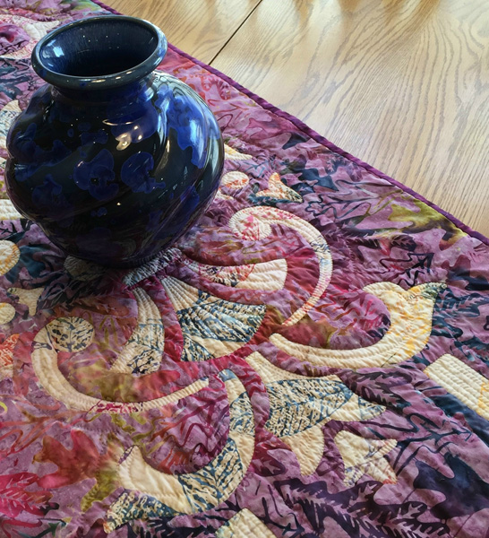 """Marrakesh, table runner V    (20"""" x 60""""), Hand or Machine reverse applique. This sample was hand stitched and hand quilted. Fabrics by Timeless Treasures."""