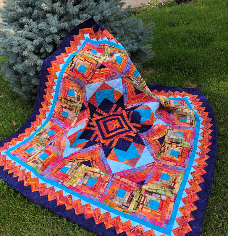"""Ojo de Dios Quilt XVI   (60"""" x 60"""") for machine piecing and Paper-piecing. Our first NON reverse applique pattern."""