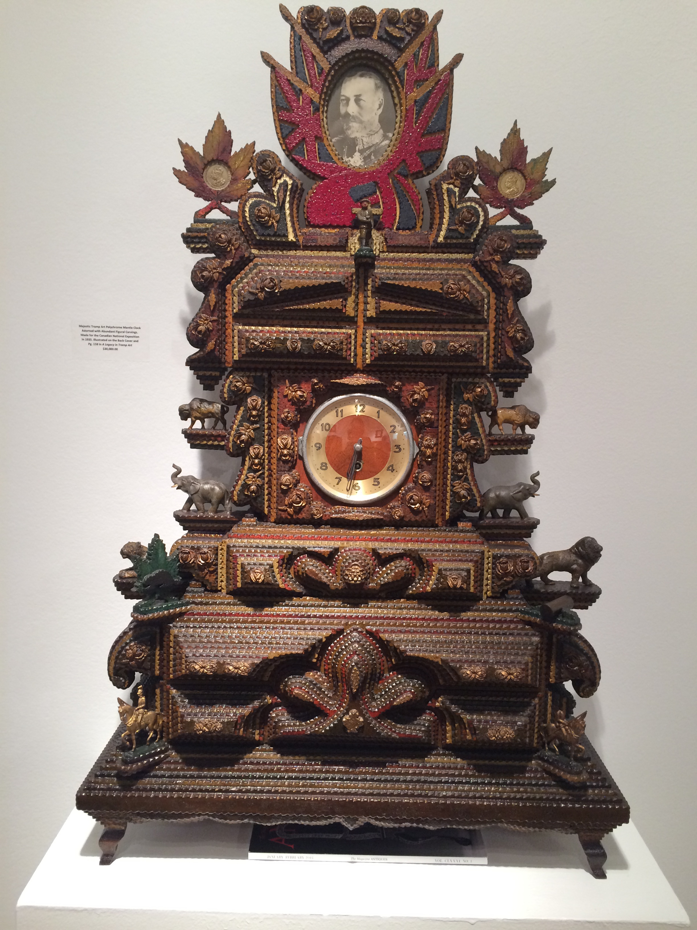 Tramp Art Polychrome Mantle Clock Adorned with Abundant Figural Carvings. Made for the Canadian National Exposition in 1935.