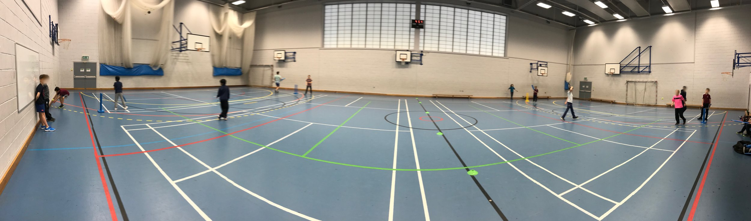 Switch cricket game in a large hall with U12 cricketers.