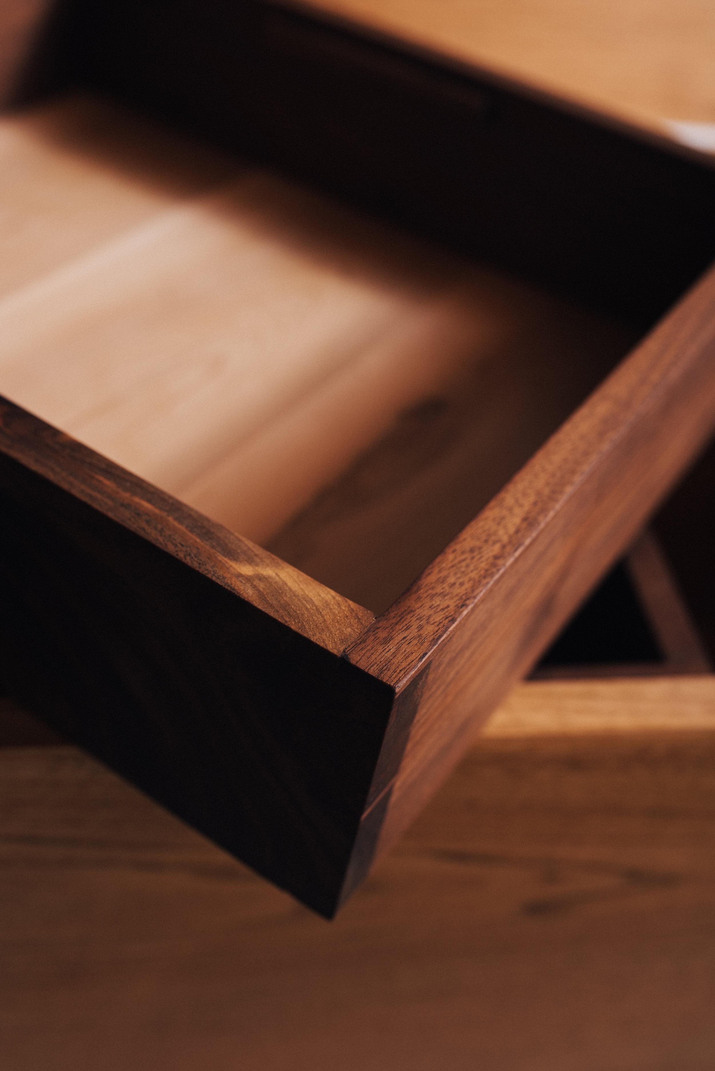 Black walnut dovetailed storage boxes. White cedar bottoms.