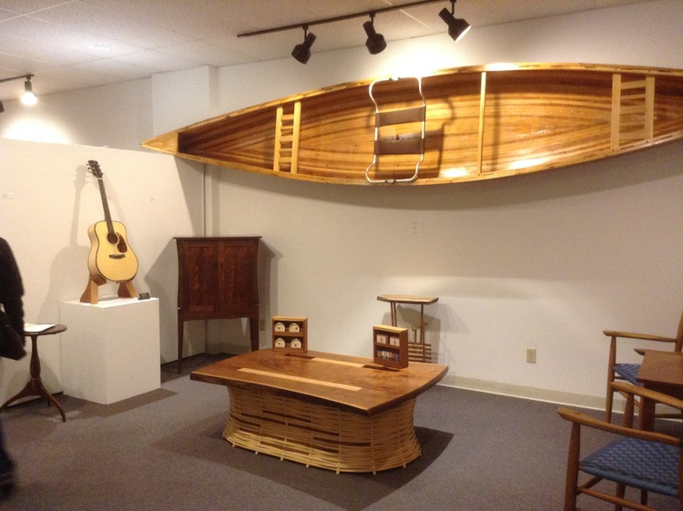 "My friend Dale Johnson displayed some of his amazing pieces, like the trapper's table and some of his guitars.Dale does some amazing works. See www.dalejohnsonfurniture.com for more info. Just to make things accessible to woodworkers of all levels, I (Paul) displayed my cedar strip canoe also--17' 8"" Freedom (bearmountainboats.com). I might add a link later on describing the process."
