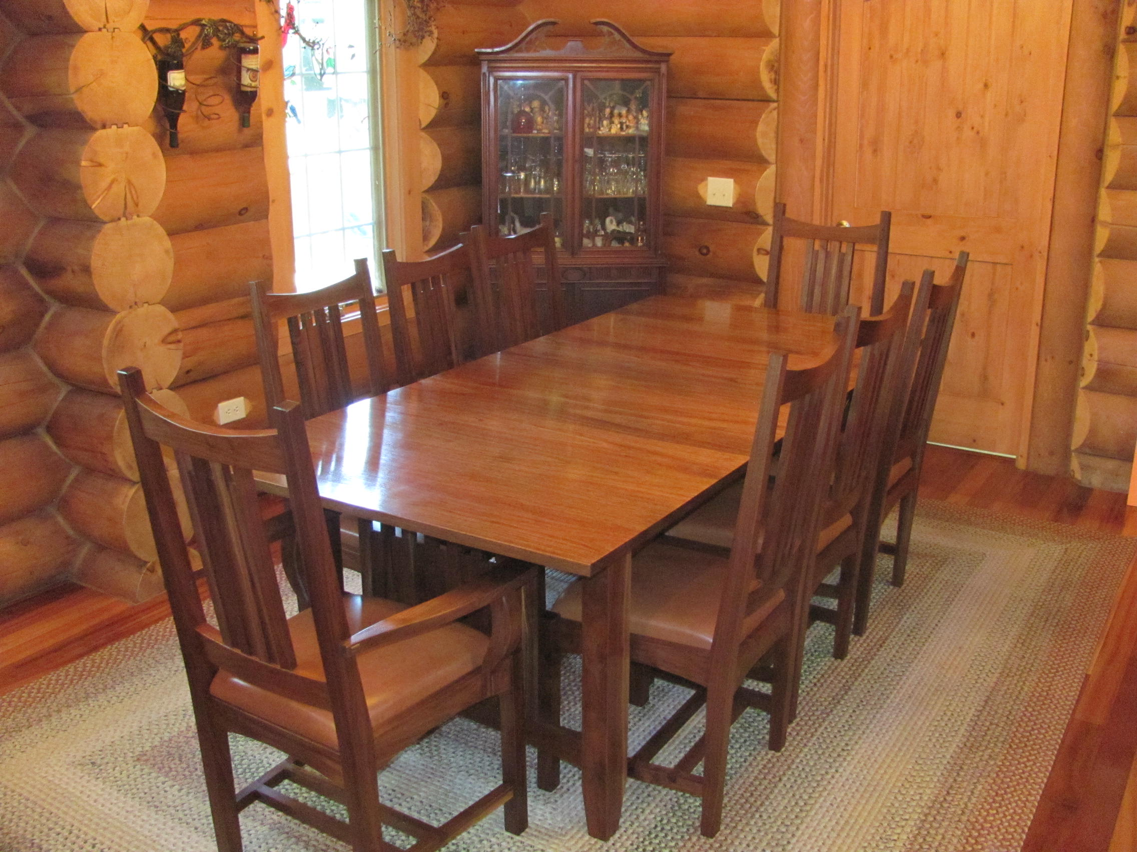 "Stunning solid black walnut mission-style table and chairs. Table 42 x 70"" with one 18"" leaf. Mortise and tenon construction."