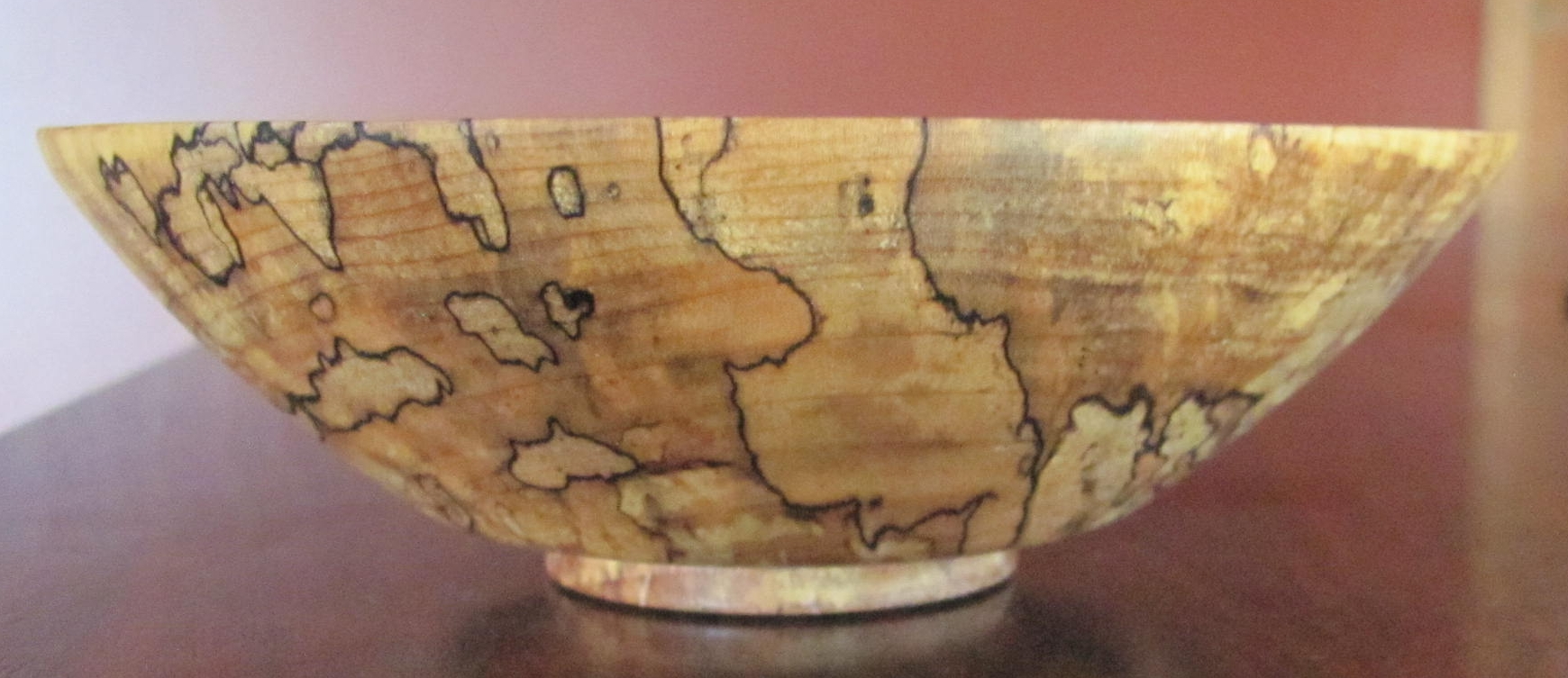An exquisite curly spalted maple bowl
