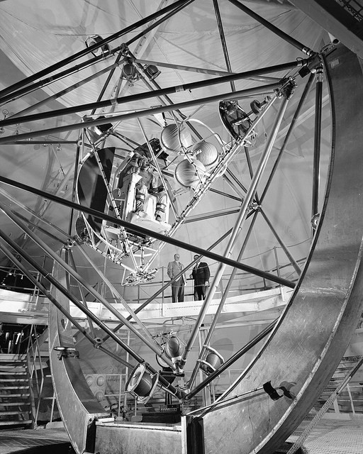 The Gimbal Rig, formally known as the MASTIF of Multiple Axis Space Test Inertia Facility, was engineered to simulate the tumbling and rolling motions of a space capsule and train the Mercury astronauts to control roll, pitch and yaw by activating nitrogen jets, used as brakes and bring the vehicle back into control. This facility was built at the Lewis Research Center, now John H. Glenn Research Center at Lewis Field. (October 29, 1957).