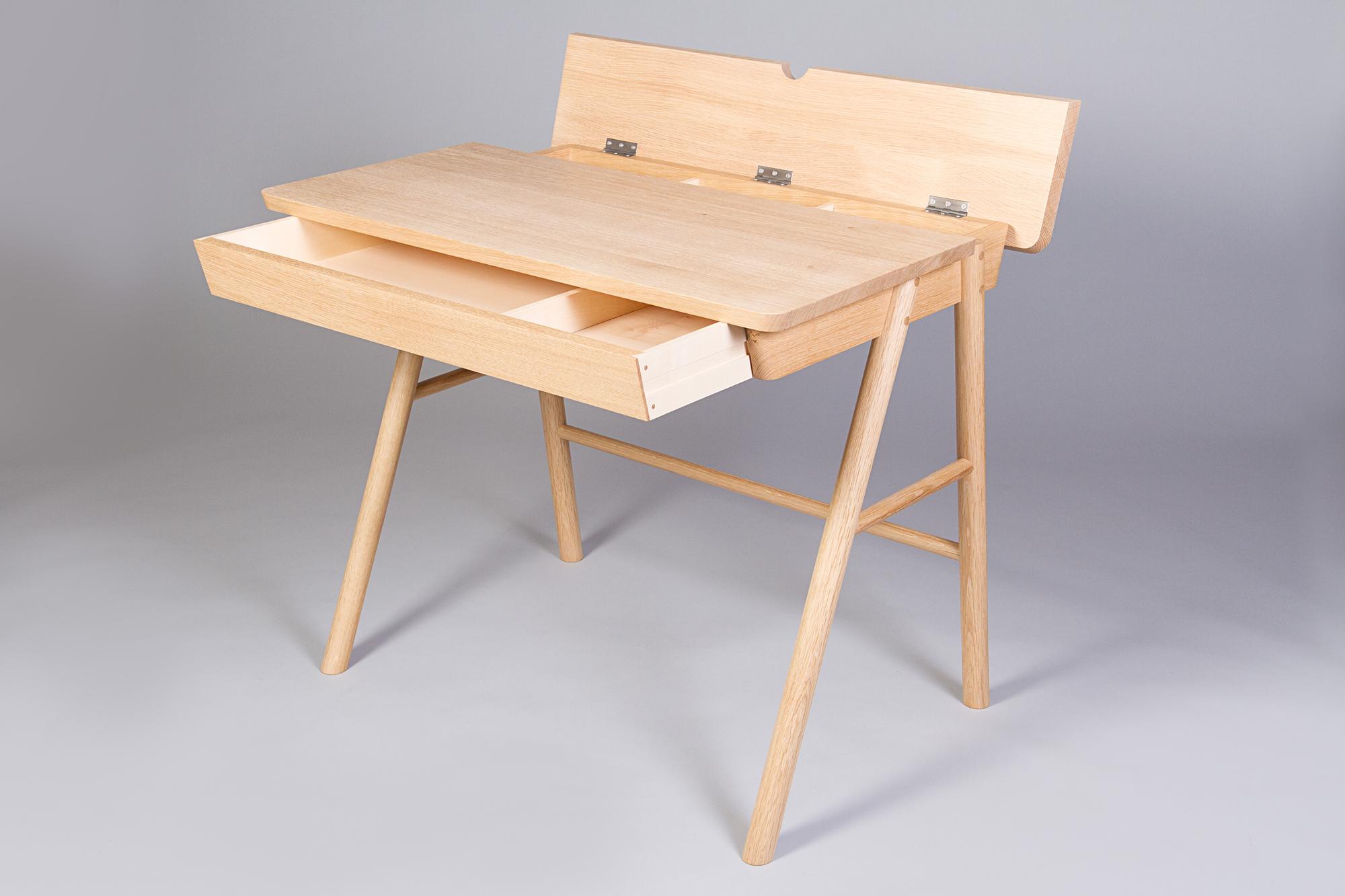 detail of storage in oak writing desk