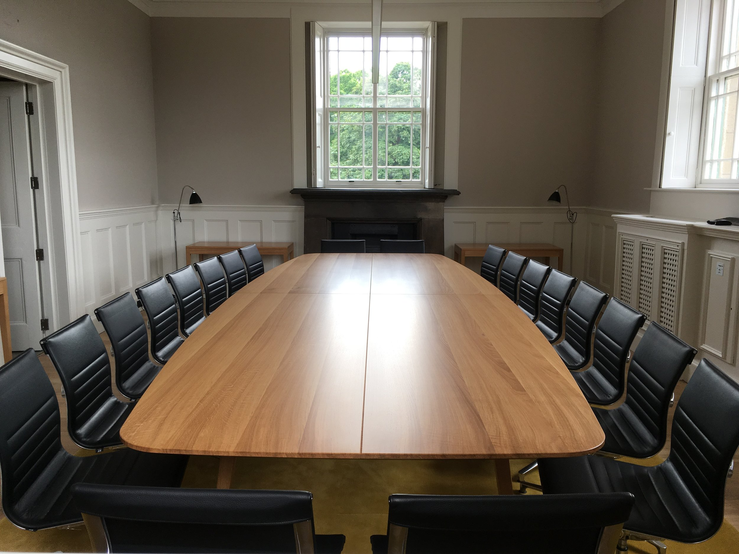 Oak boardroom table and chairs