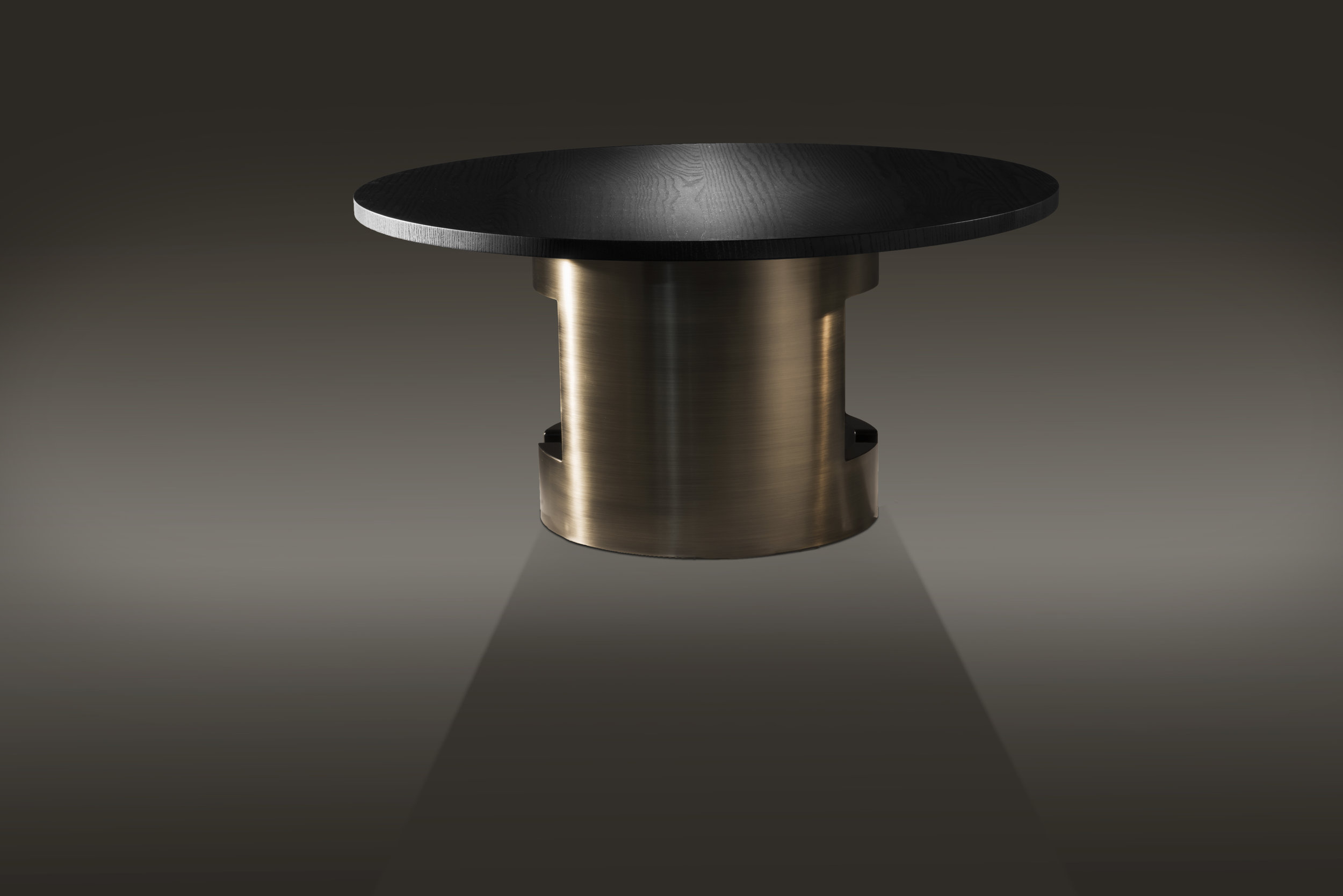 Table has burnished brass outer layer finish with a charcoal gray laquered wood interior finish and an ebonized ash wood top.