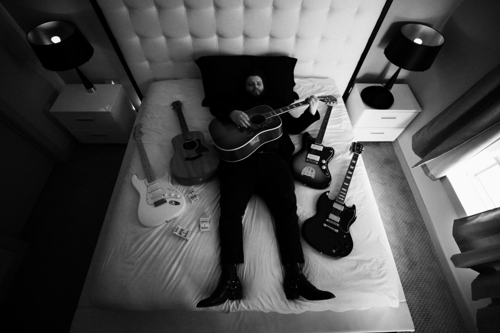 Atlanta based branding and design agency photographs Columbia Records Recording Artist Camino for Riot