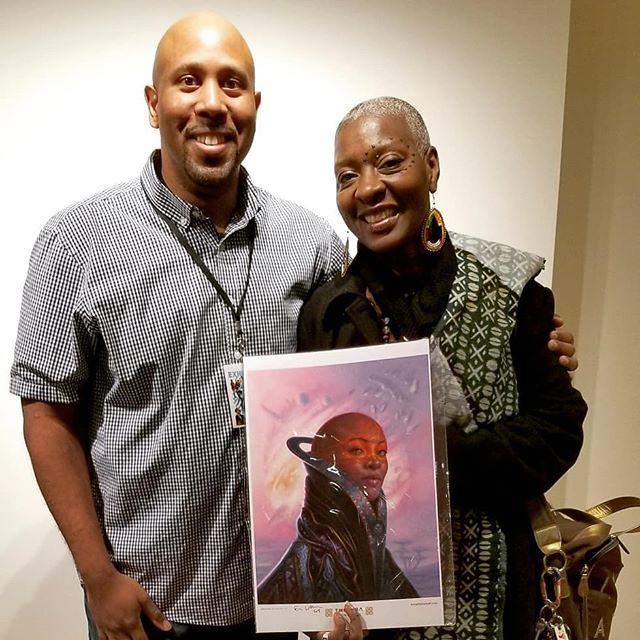 This past weekend I reconnected with my artistic muse, the lovely @photonef who was my inspiration for the afrofuturistic image she's holding. I finally got to thank her and share the impact meeting her 2 years ago has had on my work. It was a thrill just to see her again.  Big thanks to everyone who came out to support me at the 7th annual Black Comic Book Festival. Thanks to the organizers at the Schomburg for bringing us all together in such a historic place. Happy that my work has touched so many. This is my 5th year doing the show and it gets bigger and better every time. Can't wait to do it again!  #blackcomicbookfestival2019  #blackcomicbookfestnyc  #blackcomicbookfestival #blackgirlmagic #afrofuturism  #afrofuturistic #blackexcellence #instadaily #instagood