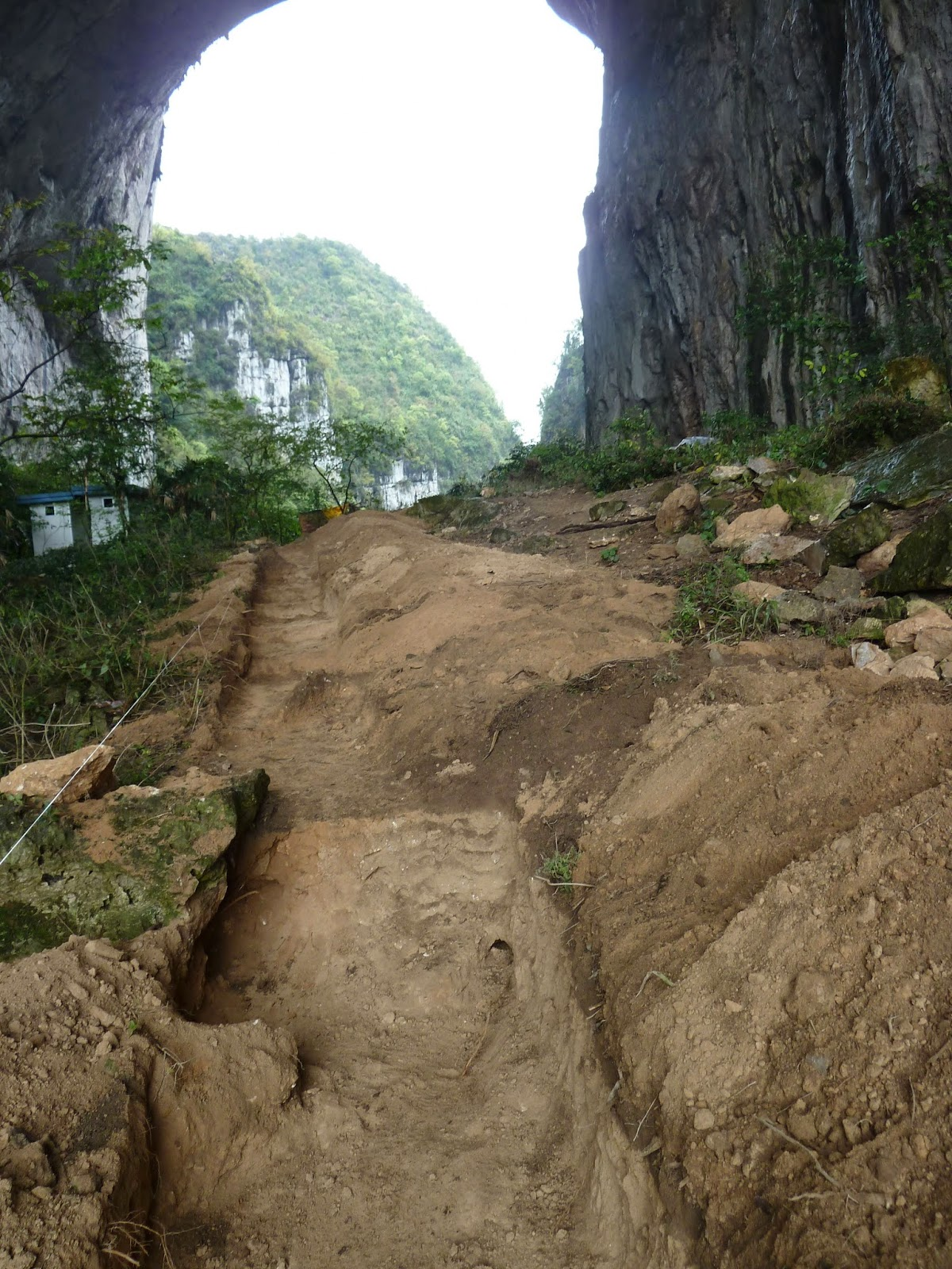 Getu in 2013. Concrete paths and excavation cut through the cave.