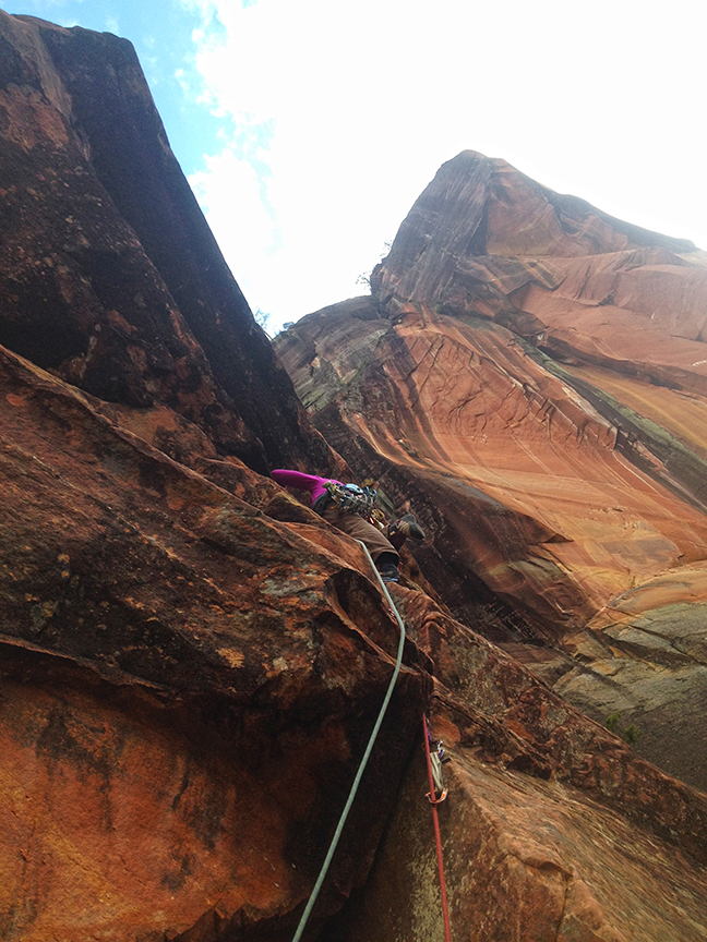 Ana Pautlerpasses the crux and enters the awesome wide hands crack above on P3.