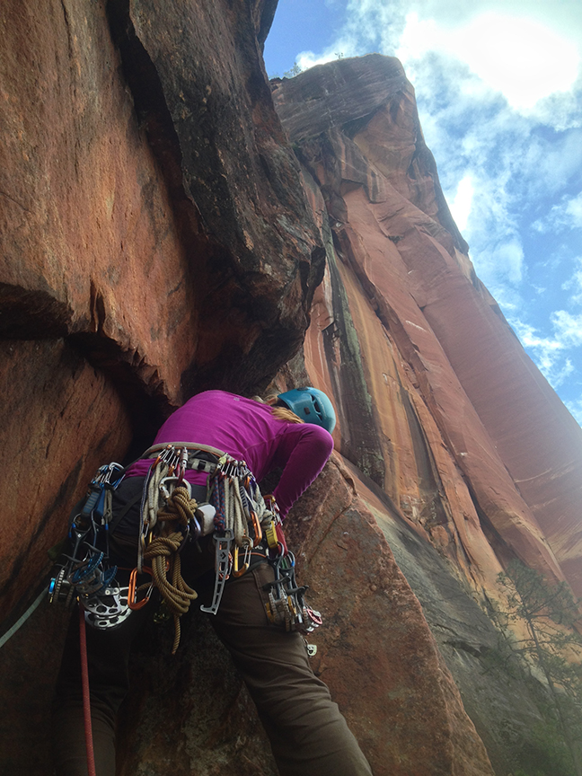 Ana Pautler climbs off the anchor and into the crux roof on P3.