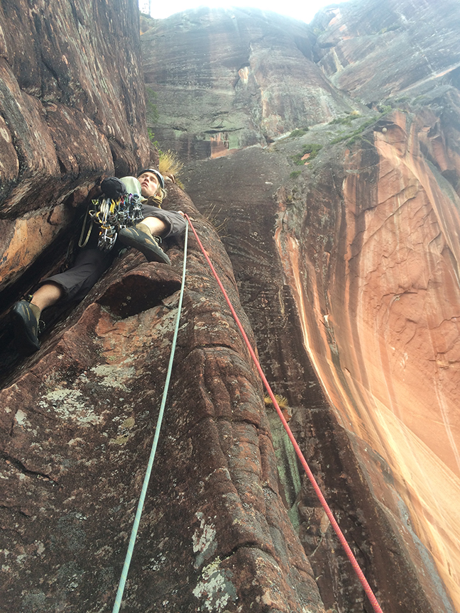 """Dan Jerke starting up in the unprotected 15m section of P5. This pitch literally puts you """"in the mountain."""""""