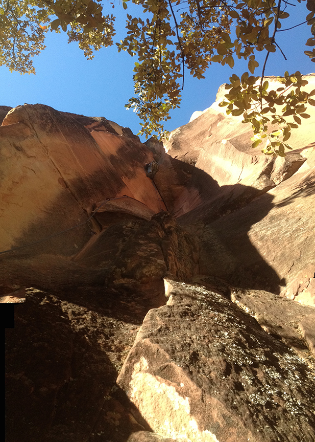Dane Schellenberg pulls through the slopey overhang and into the offwidth crux on  The Sphinx .