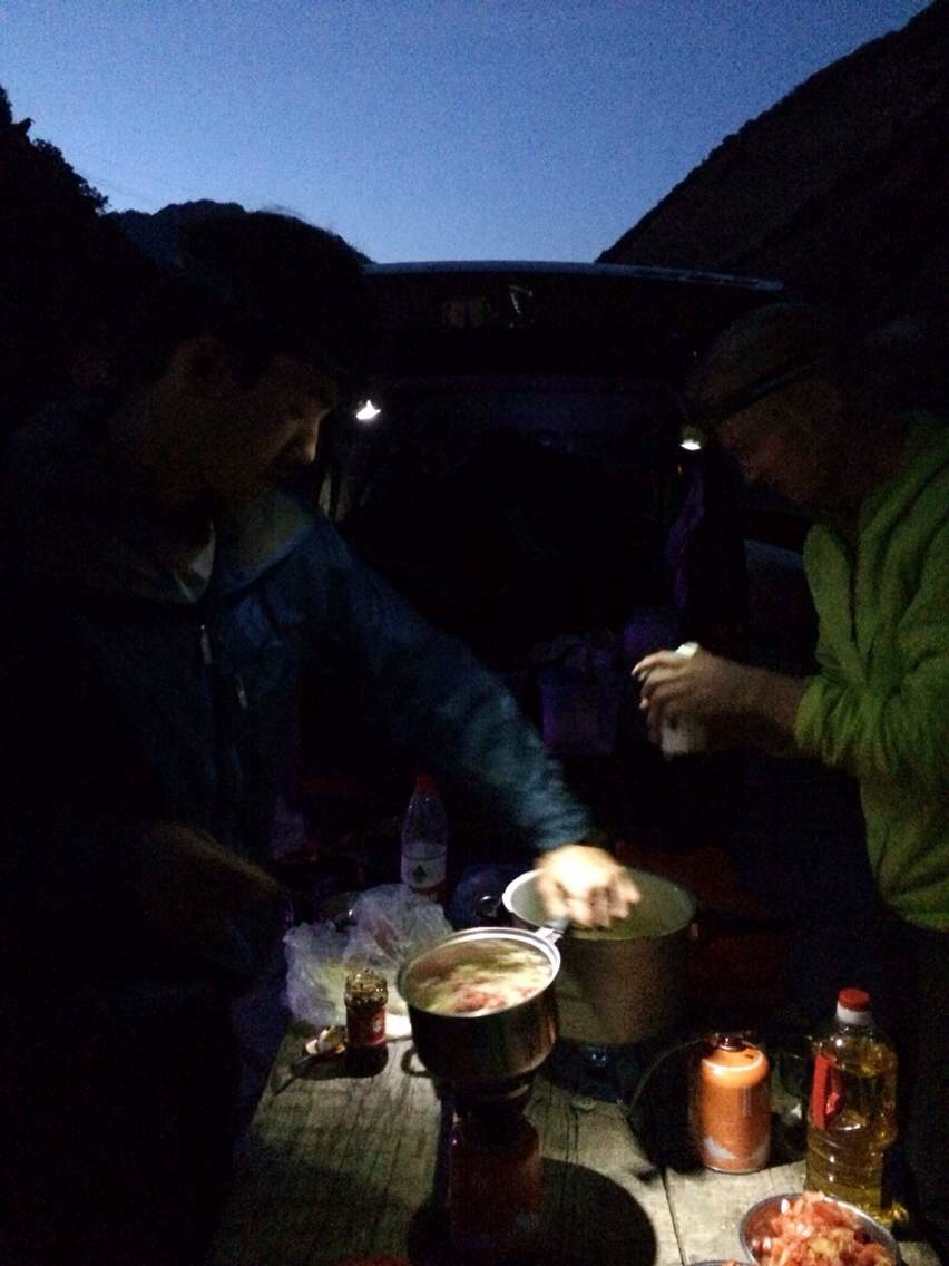 Cooking by headlamp at the van.